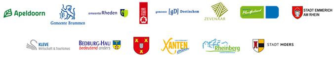 Eine Ansicht der Logos der beteiligten Städte und Gemeinden auf dem Teilbereich von Apeldoorn nach Moers auf der Oranier-Fahrradroute